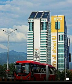 Islamabad Metro Bus, Jinnah Avenue with Ufone tower in background.
