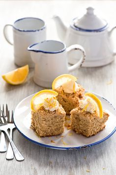 Love the inclusion of a zingy slice of lemon on these squares of Banana Cake. #cake #food #banana #dessert #baking