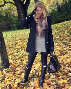 grey sweater, black leather pants, black coat, multicolored plaid scarf, and black hunter boots