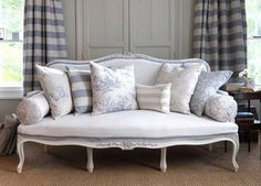 Love french style settees, even though they look uncomfortable, they look so glamorous