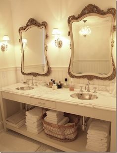 I love the white, the mirrors, the combination of stark clean with romantic and feminine.