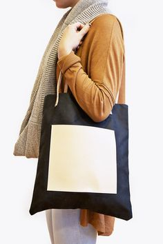 This tote is great all year round. I love the square pocket in front. Available in black, brown, and navy