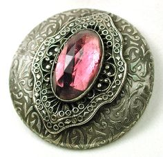 Super gorgeous antique button. Bezel set faceted jewel in a pink/lavender color. The setting is very fancy and well crafted, just stunning! Circa 1890s