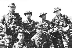 Vietnamese soldiers with M1 Carbines and US special forces soldiers with M16 rifles Vietnam September 1968.
