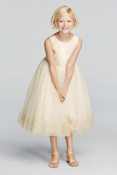 She'll shine as bright as a diamond in this tulle gown with metallic shimmer detail!  Tank tulle tea length ball gown with silver shimmer detail.  Available in white with silver metallic detail and ivory with gold metallic detail, both in stores and online.  Sizes 2T-14.  Fully Lined. Button back. Imported. Dry Clean Only.
