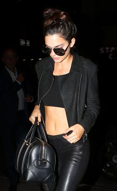 Kendall  ALL IN BLACK Jenner, wears a mid drift top, aviator shades, black leather motto jacket, leather pants and black leather purse