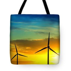 "Wind and sun energy Tote Bag 18"" x 18"". Two windmills producing green energy during sunset showing a cloudscape with vibrant sky colors."
