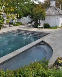 If we were to have a pool, I kind of picture it like this. I love the stone, the steps leading into the pool, and the poolside hot tub at the same level.