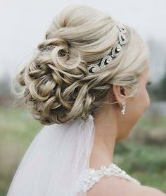 Small pompadour and bun and jeweled headband