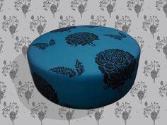 Ottoman (pouf) upholstered by client in FRUCTUS pattern with STIAK background/ Ottoman ( puff ) tapizado por cliente en patrón FRUCTUS con fondo en STIAK.