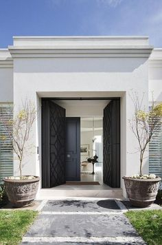 Black double front door - entering the garden of a luxurious house