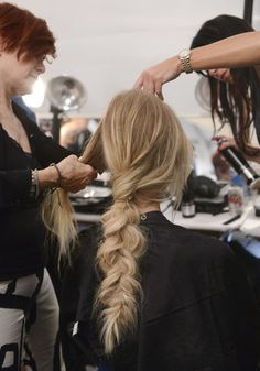 At Mara Hoffman, Nick Irwin for Catwalk by TIGI created a deconstructed braid. He prepped the plait with dry shampoo before blow-drying to get a good grip. Then this fishtail braid was pulled apart and dissected with rubber bands to get the bubble effect.  Source: IMAXTREE / Vivien Killilea