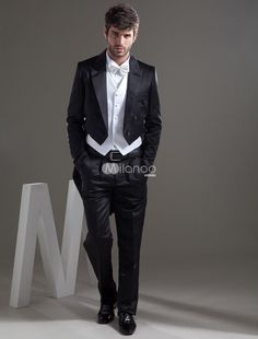 Traditional Black Worsted Groom Wedding Swallowtail Tuxedo. The swallowtail tuxedo features its double breasted detailed with matching vest.. See More Groom Suits and Tuxedos at http://www.ourgreatshop.com/Groom-Suits-Tuxedos-C918.aspx