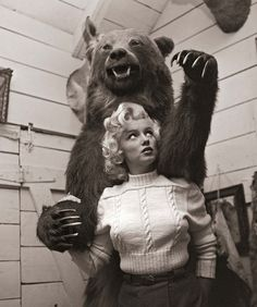 Marilyn Monroe and Bear    Marilyn Monroe is the one in the sweater.    Look Magazine, August 1953.