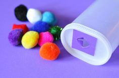 Pom Pom Stuff-It for busy bag Use a container with a lid and either cut a hole in it (and put tape around any sharp edges) or use a wipes container and fill it with pom poms.  Have your child dump them out and stuff them back in.