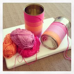 Easy, fun and effective empty tin cans wrapped in yarn, then filled with pens, crockery etc