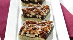 Sweet-and-Salty Truffle Bars - refrigerated sugar cookies layered with chocolate chunks and pretzels - topped with caramel mixture.