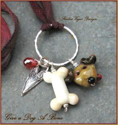 I can do whimsical too!  Adorable artisan lampwork by Lori Peterson with sterling silver on silk cord