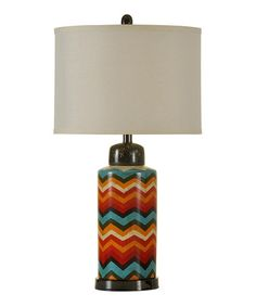 Chevron Ceramic Table Lamp  •Includes base and shade •Requires 150-watt bulb, not included •29'' H •Base: 9'' diameter •Ceramic