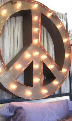 altered version...create a frame with wire hangers and wrap it with clear Christmas lights!