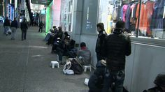 People line up outside an Apple store in Vancouver, Friday, March 16, 2012.    http://www.ctv.ca/CTVNews/TopStories/20120316/apple-ipads-go-on-sale-canada-us-120316/#ixzz1pHHm3q7B
