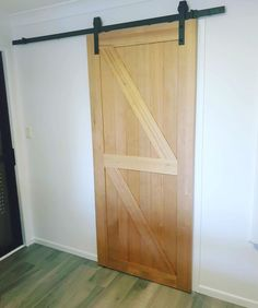 """This #barndoor was painted by one of our team members @gafdogz at our latest project with the @cbcprojects team. The owners originally wanted a """"White Wash"""" finish but then decided they wanted to showcase how naturally beautiful the door was, with just a simple Matt/Clear finish - Neilsen's Painting - House Painting Brisbane Team Member, Naturally Beautiful, House Painting, Brisbane, Curtains, Doors, Simple, Projects, Instagram"""