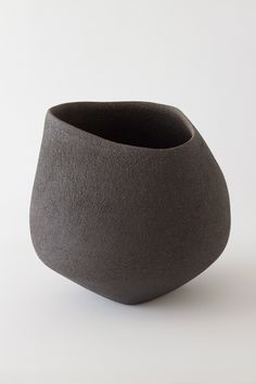 "Lithic by Yasha Butler, a ceramic artist based in Istanbul & Barcelona. ""Lithic is timeless as if it has been buried for generations, waiting to be found. Ceramic Pots, Ceramic Pottery, Pottery Vase, Thrown Pottery, Slab Pottery, Pottery Wheel, Atelier Theme, Cerámica Ideas, Black Clay"