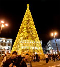 Spend the holidays in Spain! A giant Christmas tree illuminates the Puerta del Sol in the center of Madrid.