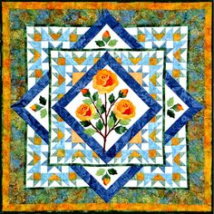 The Rose - has Bear's Paws in the corners similar to June's Grandma's quilt