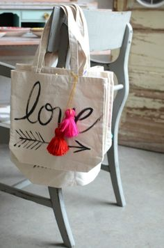 love the pom moms and hand lettering - nice purses, flower handbags, ladies purs. Best Purses, Nice Purses, Jute Bags, Printed Bags, Cloth Bags, Cotton Tote Bags, Canvas Tote Bags, Gifts, Hand Lettering