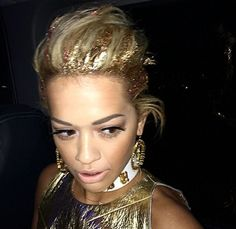 Rita Ora works some gold glitter in her hair at the Blue Balls Festival, Lucerne, Switzerland, 24 July 2014: