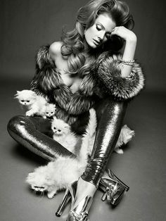 Constance Jablonksi accessorizes with kittens for Vogue Italia.