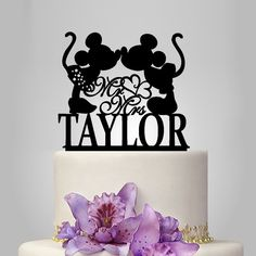 Mickey and Minnie mouse silhouette personalized wedding cake topper, mr and mrs wedding cake topper with heart decor, disney cake topper by walldecal76 on Etsy https://www.etsy.com/listing/234922414/mickey-and-minnie-mouse-silhouette
