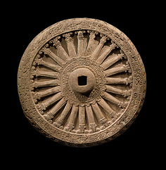 Dharmachakra (Wheel of the Law). 7th-8th century. Central Thailand. Sandstone.  http://www.metmuseum.org/exhibitions/view?exhibitionId=%7b9A312299-72C2-49CD-9AFC-DE56BDFCF6BD%7d&oid=77762&pg=6&rpp=20&pos=106&ft=*