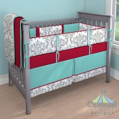 Crib bedding in Gray Traditions Damask, Solid Teal, Solid Red. Created using the Nursery Designer® by Carousel Designs where you mix and match from hundreds of fabrics to create your own unique baby bedding. #carouseldesigns