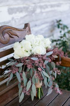 White wedding bouquet with eucalyptus | Private Residence Rustic Alabama Wedding On The Steps Of Great Great Grandads Porch | Photograph by Freshly Bold Photography  http://storyboardwedding.com/private-residence-rustic-alabama-wedding-steps-great-great-grandads-porch/