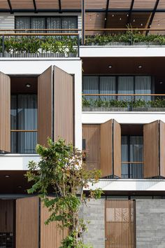 Gallery of Trung Villa / EVITArchitecture - 2 Arch House, Facade House, Building Elevation, Building Facade, House Elevation, Modern Wooden House, Wooden House Design, Mini Clubman, Aluminium Cladding