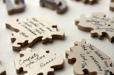 have your guests sign a piece of the puzzle, then frame it after.  how cute is that!?