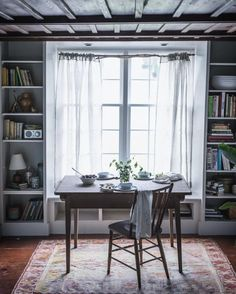 Lovely breakfast area. Airy and light with built-ins framing the window with a touch of sophistication. Simple and elegant.