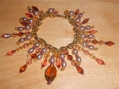 Beautiful OOAK Cha-Cha Bracelet Browns and Gold tone by TrendyCharm on Etsy