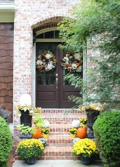 fall-front-porch-with-pumpkins-and-mums-plus-dark-stained-wood-doors-at-refresh-restyle 9/2016