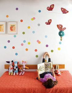 Has a link to Fawn & Forest/ Petit Collage- which has the confetti wall decals, art on the wall and dolls in the photo. All super for a kids room.