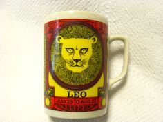 Mouse over image to zoom    Have one to sell? Sell it yourself  Vintage Coffee Mug Royal Crown Zodiac Leo By Elena 3338 8 oz Red Yellow Purple