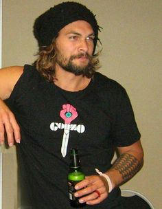 Jason Momoa, wearing a Gonzo shirt, being even more perfect than anyone had thought possible.