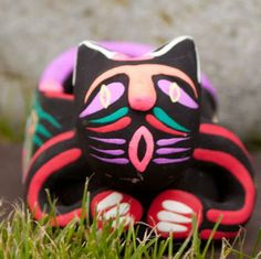 Beautifully made and brightly hand painted, clay cat ash tray