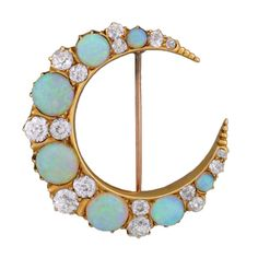 A breathtaking opal and diamond crescent pin from the Art Nouveau (ca1900) era! Made of 14kt yellow gold