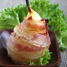 Williams pear wrapped in bacon and stuffed with Gorgonzola. Made this tonight such a winner didn't stuff them though.