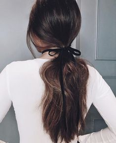 Here's an easy styling option for fancy spring nights - simply tie a velvet ribbon around your low ponytail for a sleek evening look #ponytail #brownhair