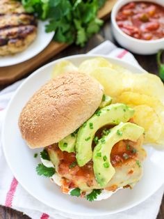 Green Chile Grilled Chicken Burgers with cheese, avocado, and salsa — Our favorite weeknight meal. EASY and healthy! @wellplated