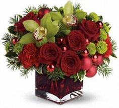 Christmas Rose Arrangement Gifts starting as low as ; choose from wide range of expert designed Christmas Rose Arrangement Gifts online. All gifts come with free card message and best value guarantee. Christmas Flower Arrangements, Rose Arrangements, Christmas Centerpieces, Christmas Decorations, Floral Centerpieces, Vase Decorations, Winter Floral Arrangements, Red Christmas Ornaments, Christmas Flowers
